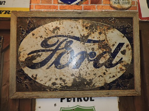 Wood framed Ford enamel sign