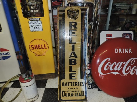 Reliable batteries embossed tin sign