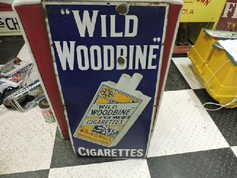 Wild Woodbine enamel tobacco sign