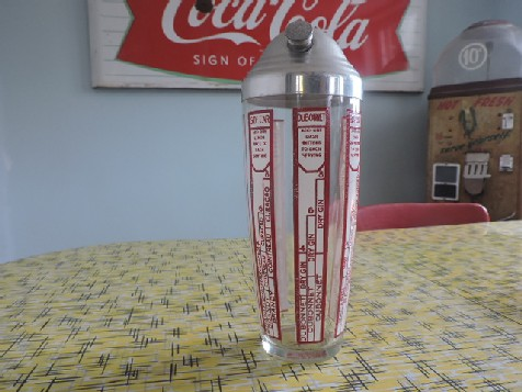 Original vintage glass cocktail shaker with drink recipes