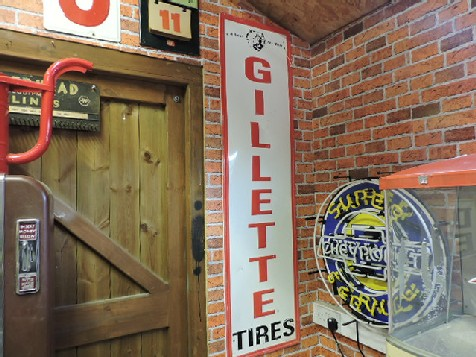 Gillette tires embossed tin sign