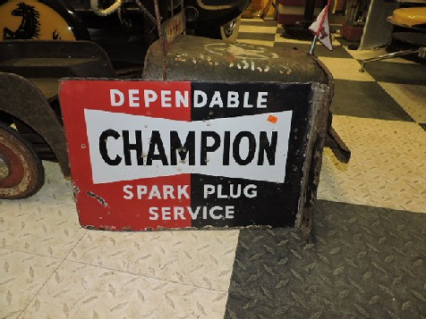1951 enamel Champion spark plug flange sign
