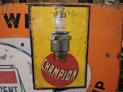 Early embossed tin Champion spark plug sign