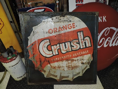 Orange Crush embossed tin sign