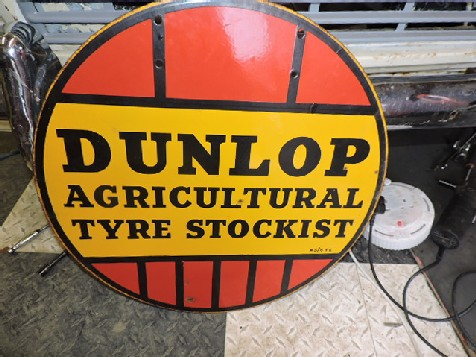 Round Dunlop agriculture enamel tyre sign