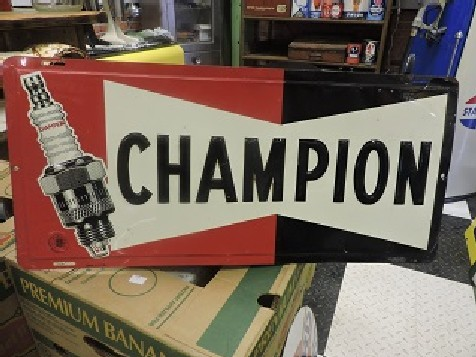 1960s Champion spark plug embossed tin sign