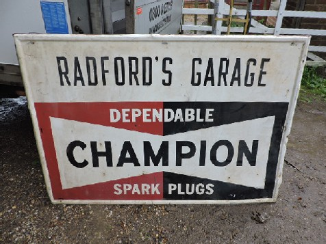 Radfords garage Champion spark plug sign