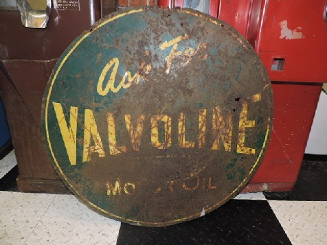 Ask for Valvoline circular sign