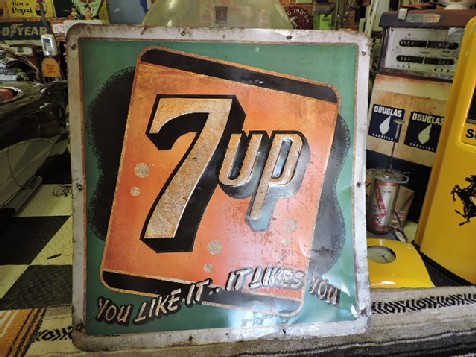 Embossed 7up tin sign