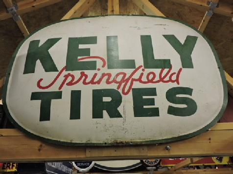 1956 Kelly tires painted tin sign
