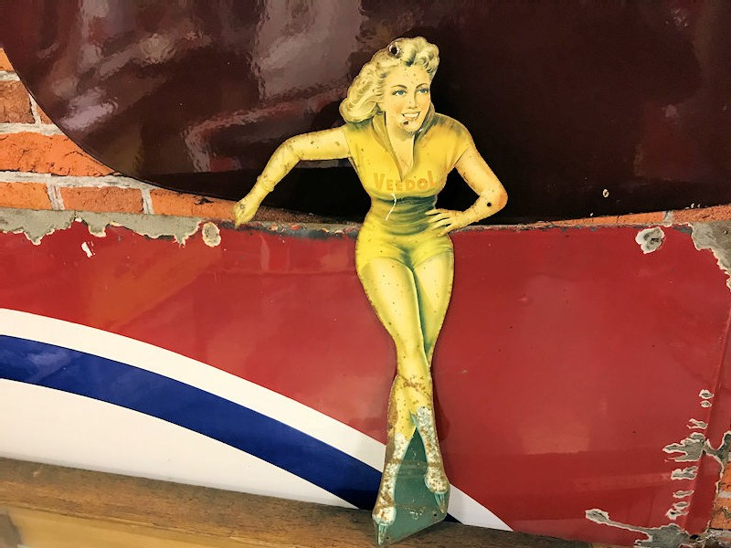 1950s Veedol die cut tin pin up girl sign