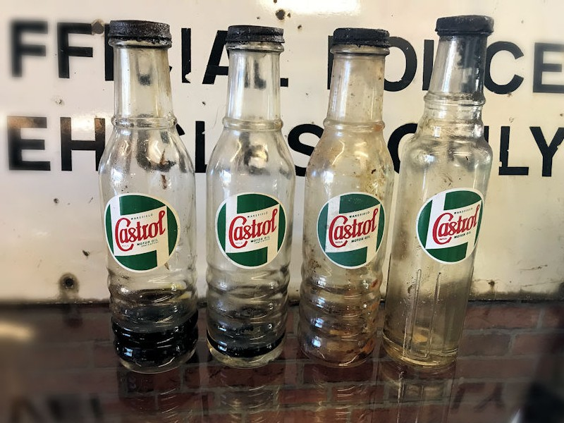 Original glass Castrol oil bottles
