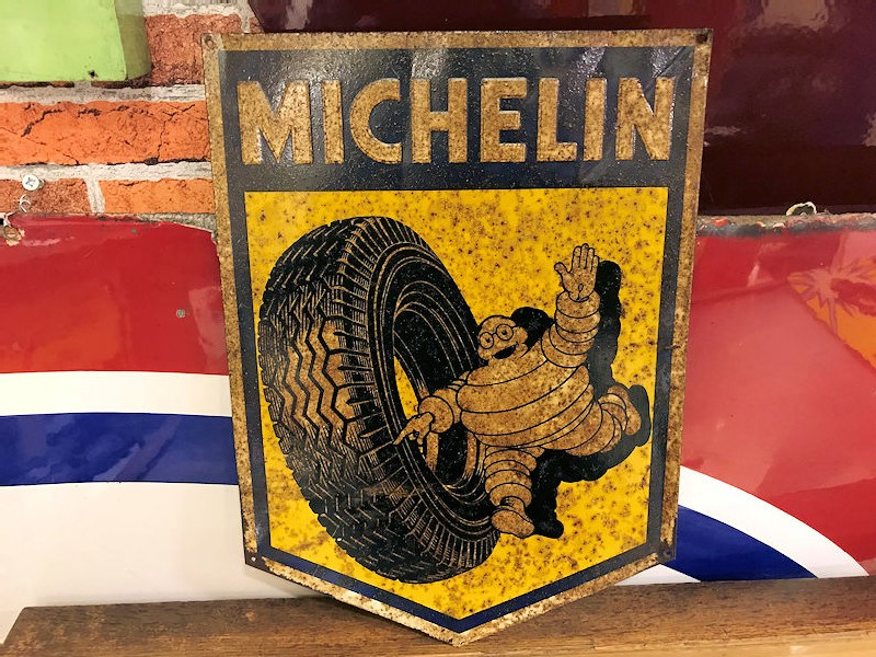 Small embossed tin Michelin shield shaped sign