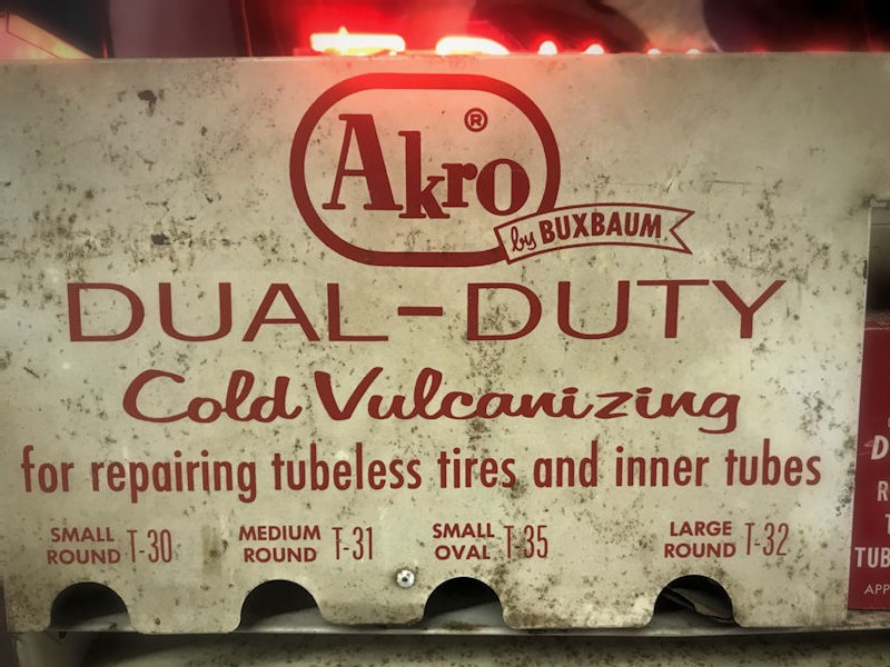 Akro by Buxbaum tire repair kit diplay cabinet and patches