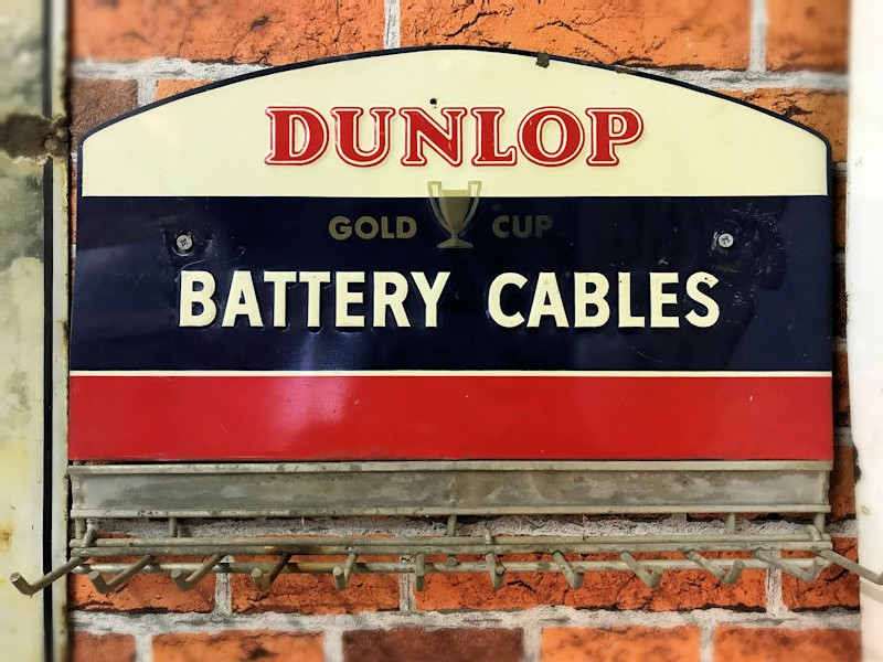 Original embossed painted tin Dunlop battery cables wall mounted display rack