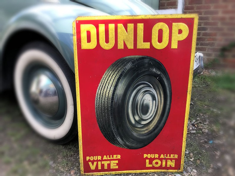 Embossed tin Dunlop sign