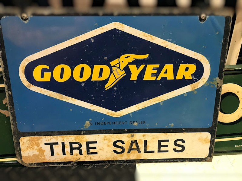 Original double sided tin Good Year Tire Sales sign and bracket