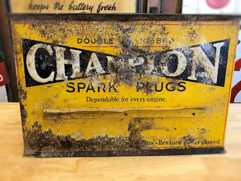 1940s embossed Champion spark plug counter display