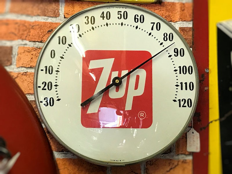 Selection of vintage automibilia and 7 Up thermometers