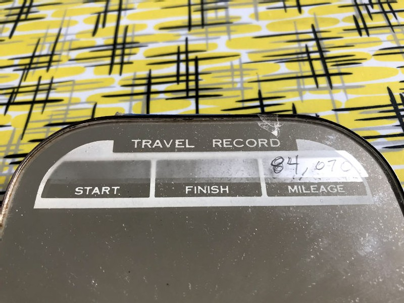 Original rear view travel and service record mirror