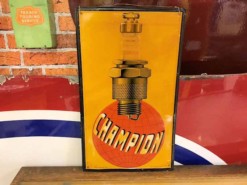 1930s Champion Spark Plug embossed tin sign