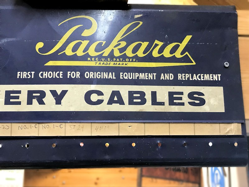 Original painted tin Packard battery cables rack
