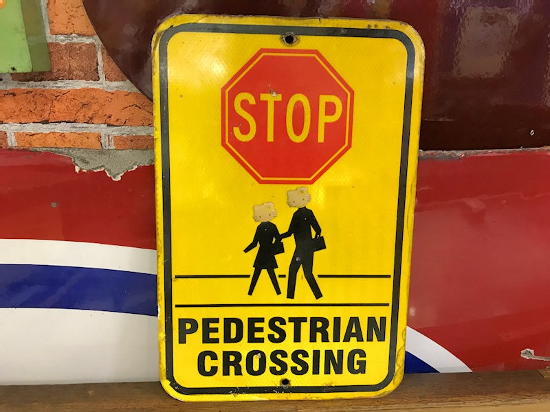 American cats eyes reflective Stop pedestrian crossing sign