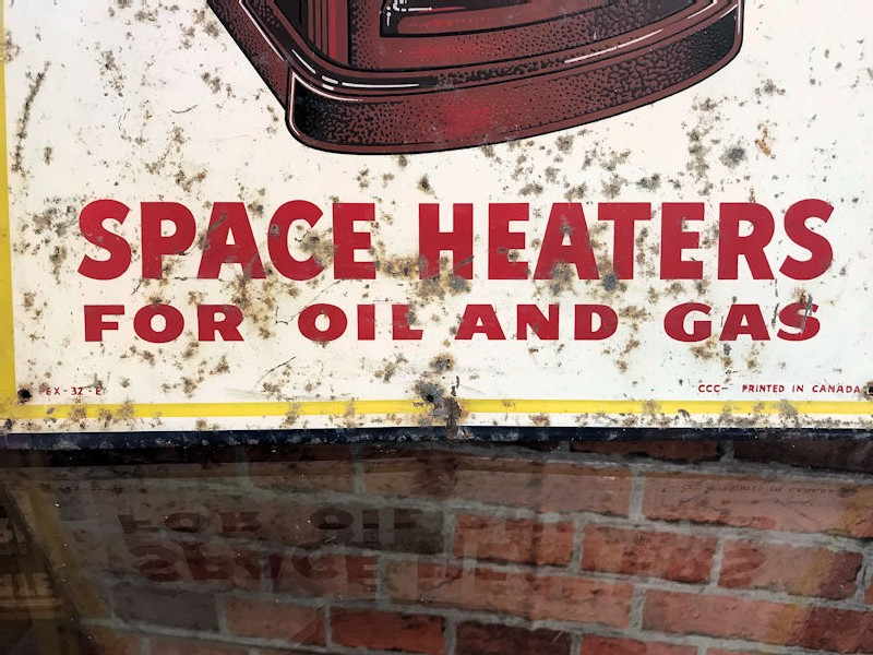 Printed tin Coleman space heaters sign