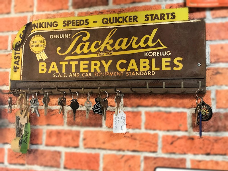 Original Packard battery painted tin cables rack