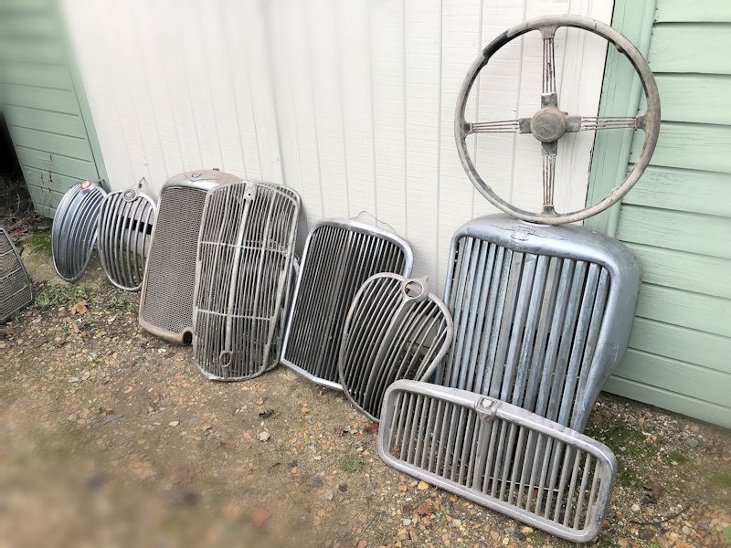 Selection of original vintage front grills and steering wheels