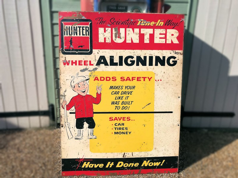 Original 1962 painted tin Hunter wheel aligning sign