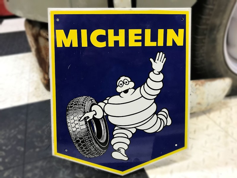 Original 1970s new old stock painted tin Michelin sign