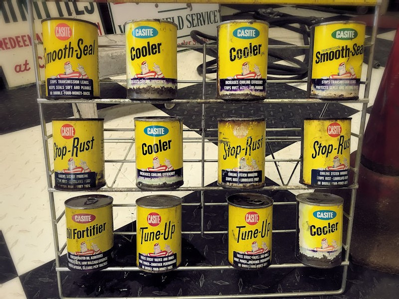 Original Casite oil rack and 12 cans