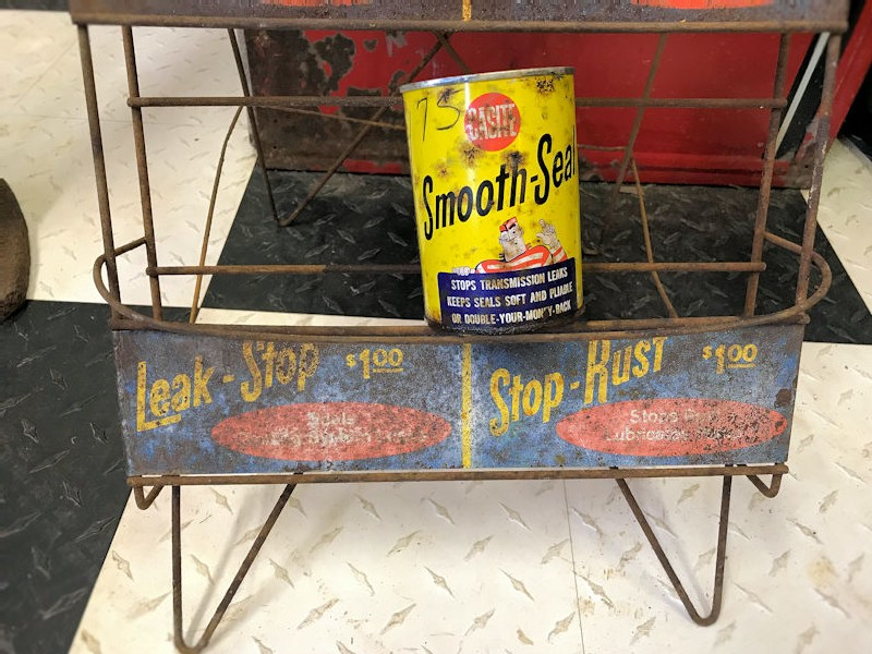 Vintage Casite oil can rack and cans
