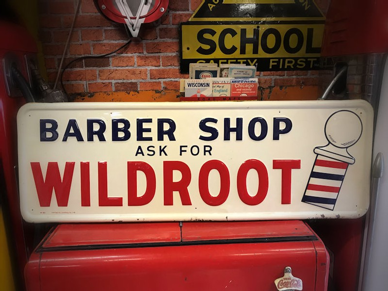 1956 wildroot hair tonic embossed tin barber shop sign