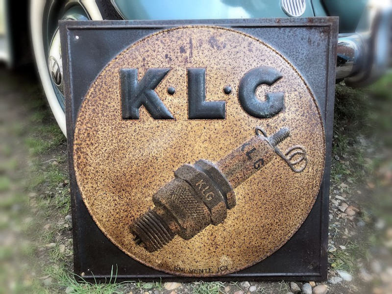 Embossed tin KLG spark plug sign