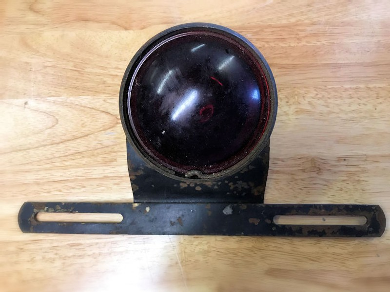 Original vintage stop and tail light with licence plate holder